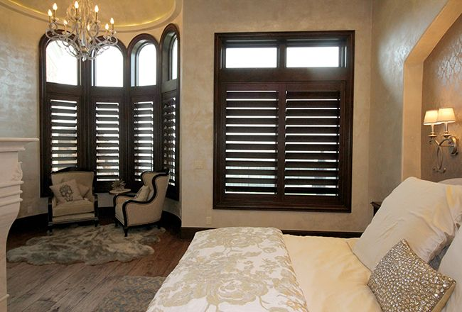 Knotty Alder Wood Stained Shutters In The Master Bedroom