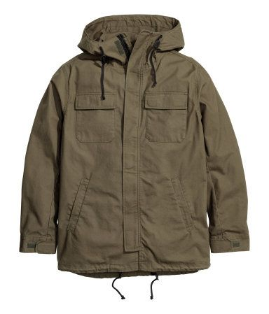 Khaki green. Parka in woven cotton fabric with a hood. Zip and wind flap at front with hook-loop fastener, chest pockets with flap and hook-loop fastener,