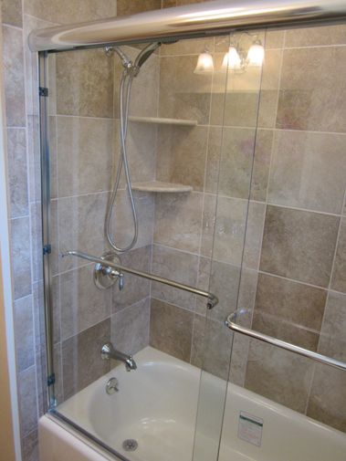 12x12 ceramic tiled wall that can be seen through the for Bathroom designs 12x12