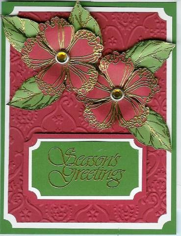 handmade card: Ruffled Christmas by Happy Heart ... red and green with white mats and gold embossing ... luv how the flowers and leaves are gold embossed on colored card stock, fussy cut, slightly shaped and arranged on the card ... beautiful card!