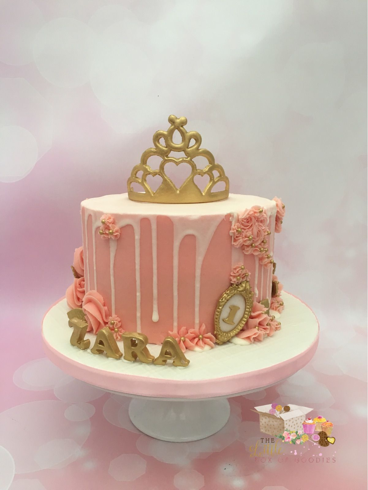 First Birthday drip cake in pink, white and gold