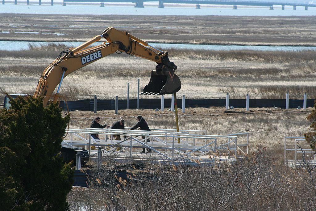 Laying down the new marsh walkway Walkway, Marsh, Rebuild