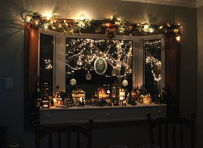 pretty much how i decorate my bay window for christmas like the idea of adding lit garland to top - How To Decorate Windows For Christmas