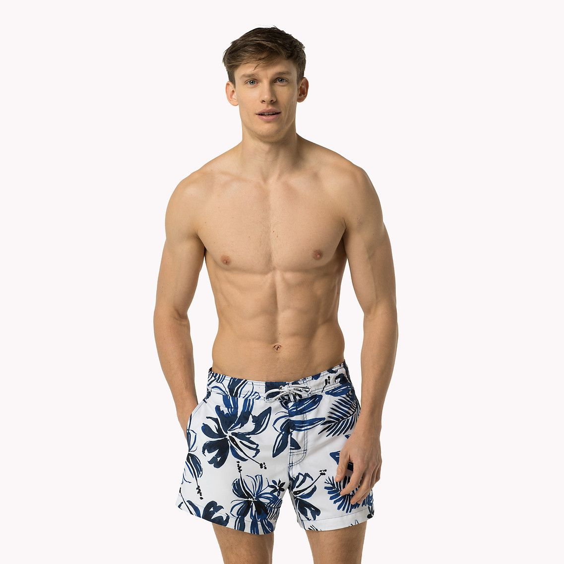 94511819a0343 Shop the white printed swim shorts from the latest Tommy Hilfiger swimwear  collection for men. Free returns & delivery over 50£. 8719255319738