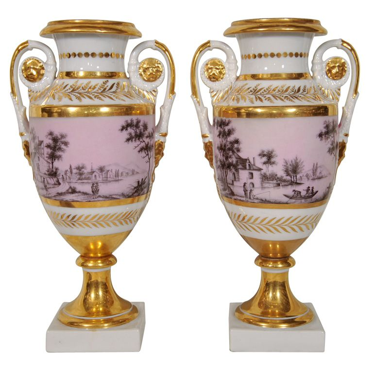 A Pair of Vieux Paris Vases France c1840 A Pair of French, lavender color, Paris porcelain vases feature continous hand painted riverside scenes. Bands of gilded leaves frame the scenes. The handles have gilded lion head masks.