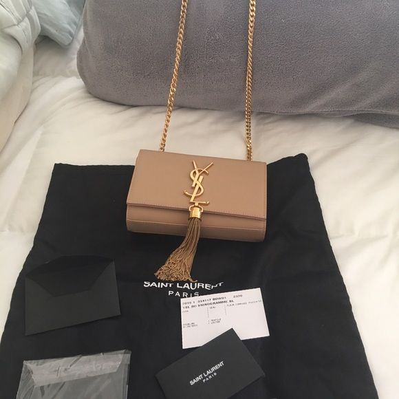 Saint Laurent cross body bag. Pre loved ysl bag in powder color. Retail  1890. The shoulder strap can be worn double or single. Cute size for party. 0cd7f271c468b