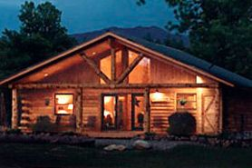 Night Time Shot Of A Cabin At Cabins At Hartland Ranch In The Pagosa