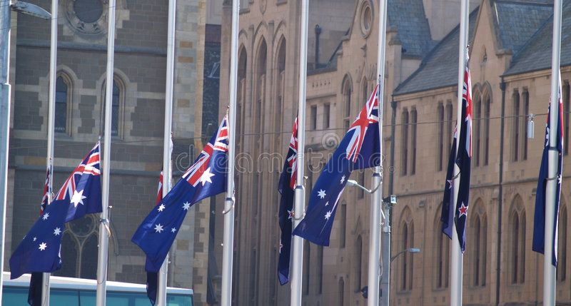 Half Mast Australian Flags Flying At Half Mast During Anzac Day Celebrations In Affiliate Flying Mast Flags Mast Half Mast Stock Images Anzac Day