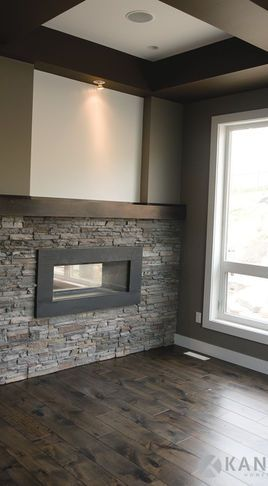 half wall with stone fireplace