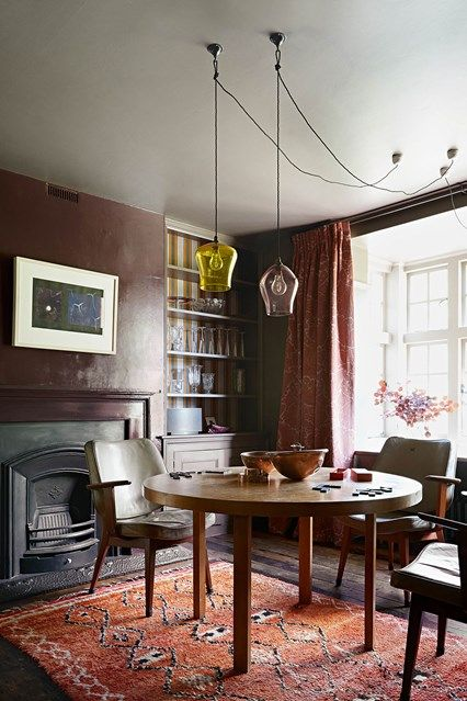 I Love This Moody Fall Dining Room In Renovated Georgian Farmhouse Dark With Pendant Lighting Rich Red Colour Scheme Original Fireplace And