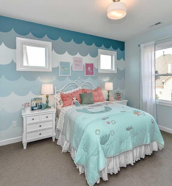 mermaid themed bedroom complete with ocean wave detail on