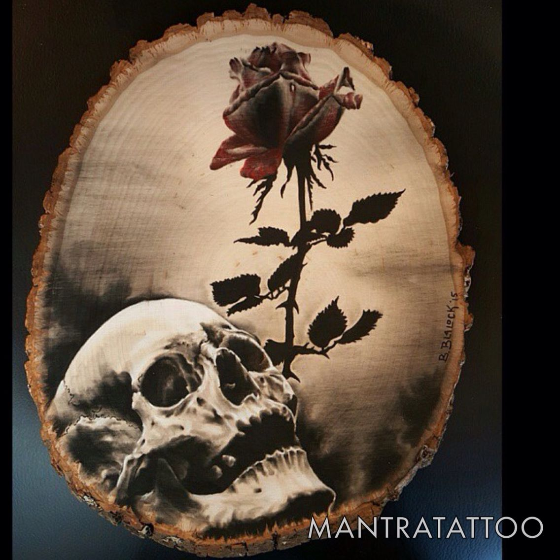 Beautiful charcoal piece on a piece of trunk wood by Brian Blalock here at @mantratattoo