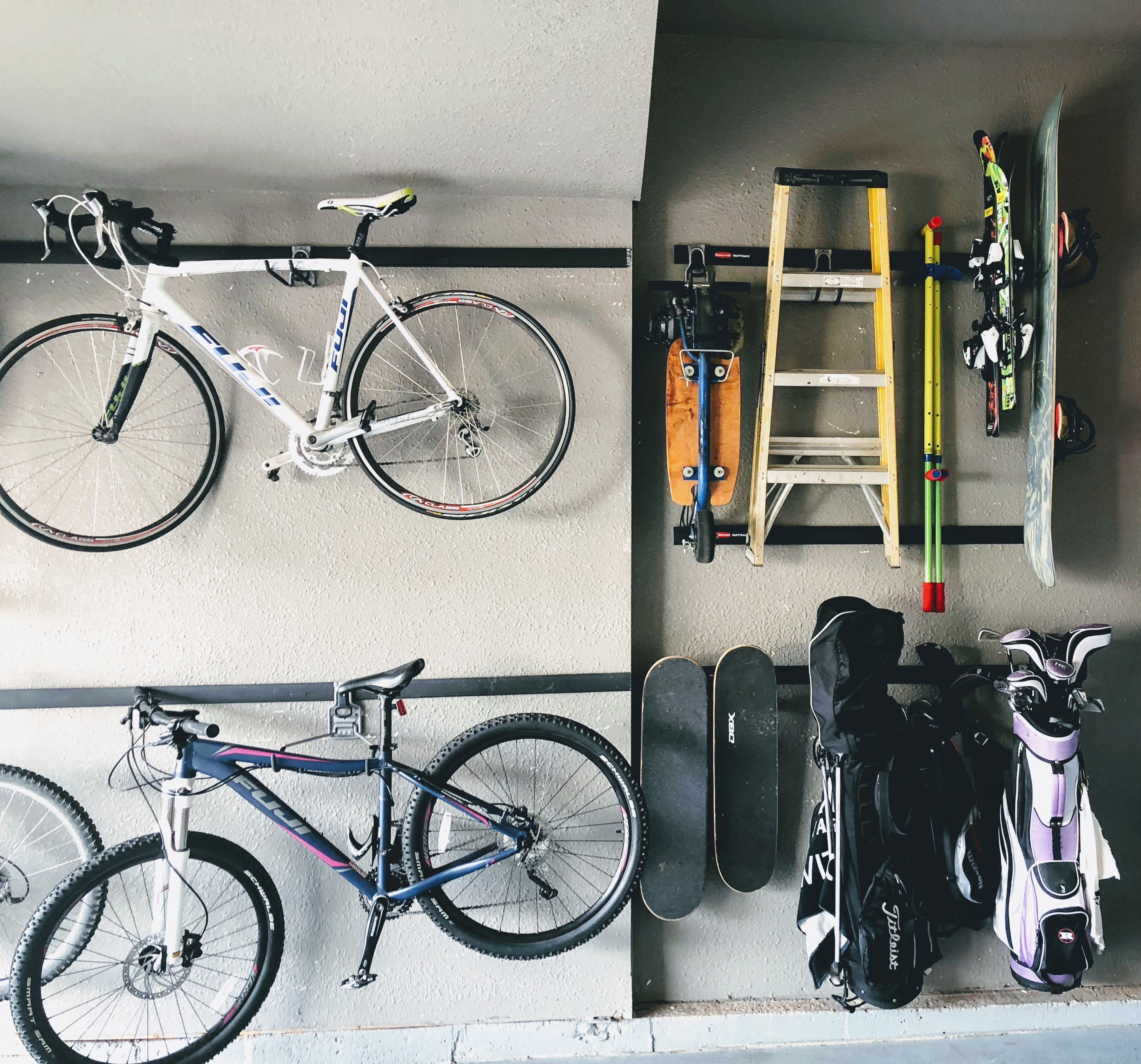 Garage Storage And Garage Organizing Hanging Bike Rack And Golf Bag Storage Off The Floor And R Home Organization Garage Storage Organization Hanging Bike Rack