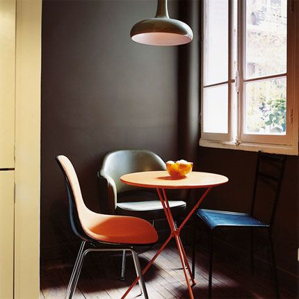 Cosy space made by putting up a thin wall to slice off a bit of the kitchen and hide the fridge...