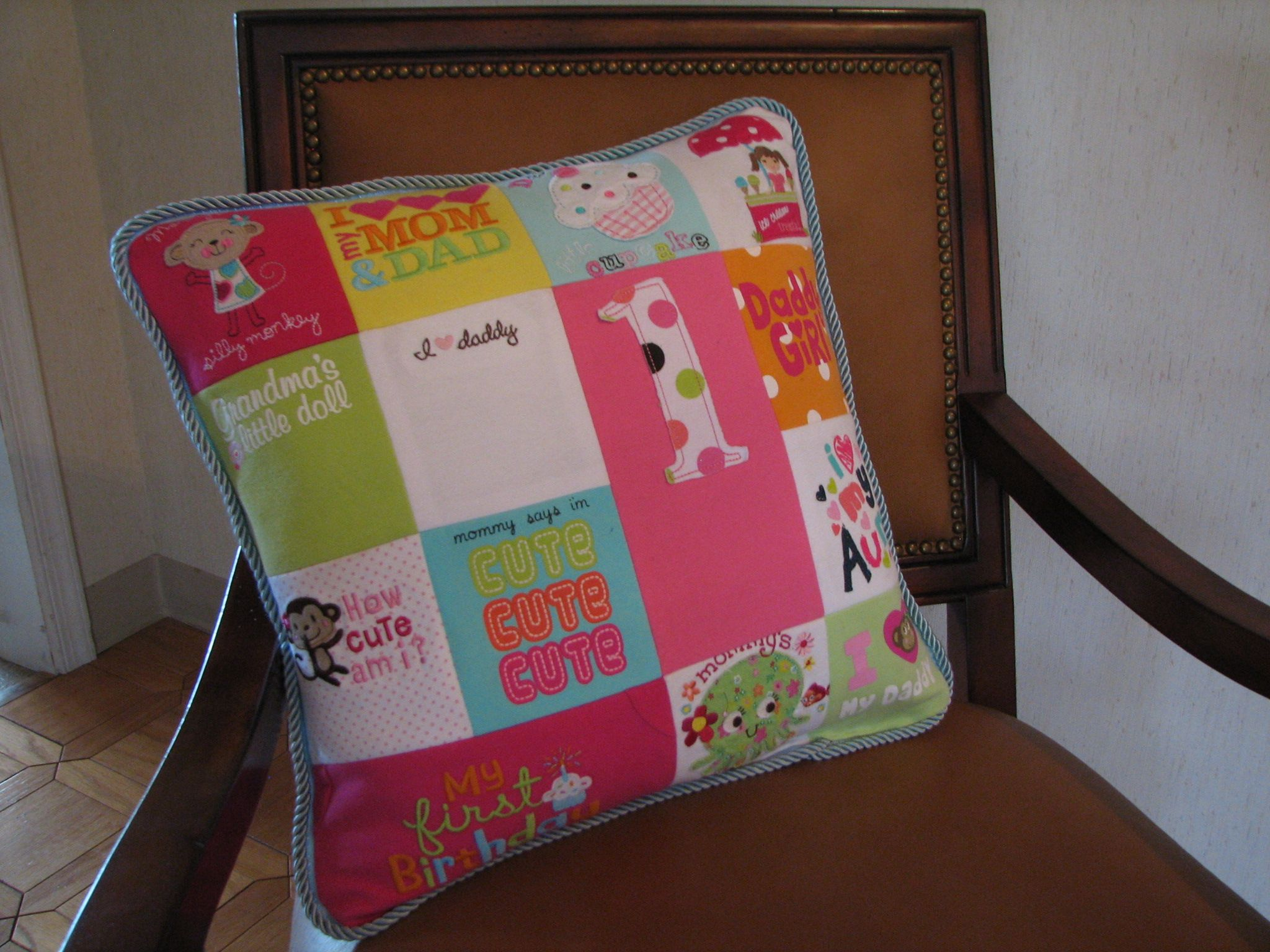 A memory pillow made out of baby clothes onsies are soooo