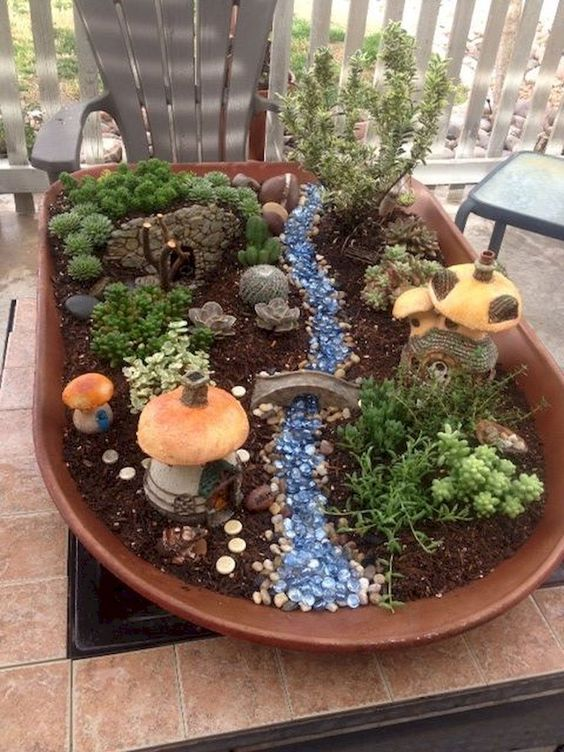 62 DIY Miniature Fairy Garden Ideas to Bring Magic Into Your Home  Page 32 of 62 is part of Fairy garden designs, Indoor fairy gardens, Fairy garden diy, Fairy garden, Miniature fairy gardens, Small garden fairies - People usually seek for Fairy Garden Ideas to make it look mesmerizing  One can create a fairy garden by identifying the items to be used and just has to dig deep into the mind to come up with an idea  The simpler the idea is, the easier it is to create  The whole mix of Fairy garden ideas depends upon the imagination of a person  It is possible to also propagate your very own succulent pups from cuttings  It is very important to contemplate where you want to place your fairy garden  At times the ideal fairy gardens are nestled into landscaping you presently have
