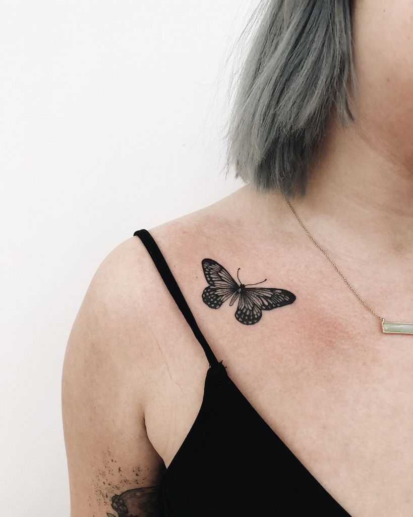 Black Small Butterfly Tattoo On The Clavicle Bone Tattoogrid Net Small Butterfly Tattoo Butterfly Tattoo Butterfly Tattoos Images