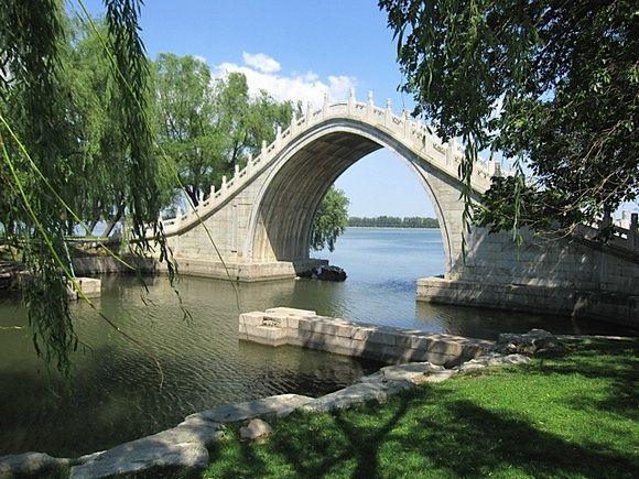 The Jade Belt Bridge, also known as the Camel's Back Bridge, is an 18th century pedestrian Moon bridge located on the grounds of the Summer Palace in Beijing, China. It is famous for its distinctive tall thin single arch.