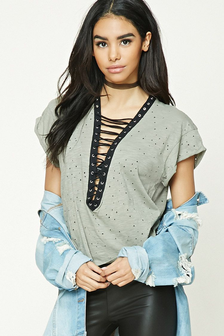 c2ae9a06b5 A knit top featuring an allover distressed design
