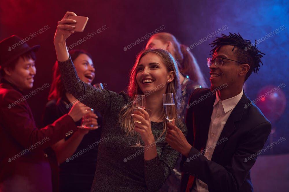 Young People Taking Selfie in Nightclub By seventyfourimages鈥檚 photos #Ad , #SPONSORED, #People, #Young, #Nightclub, #Selfie