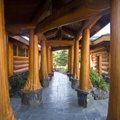 tree bases as support posts on log home patio | Make mine rustic ...