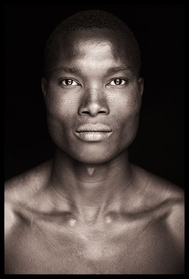 West African portrait by John Kenny Amazing symmetry in this man's face...