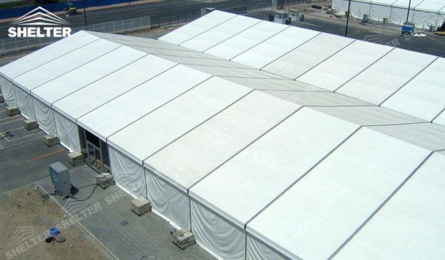 A construction tent covered by insulated PVC vinyl provides