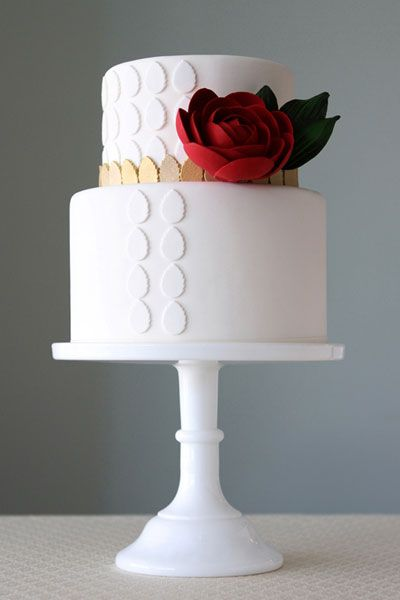 10 Extraordinary Wedding Cake Designs. - - 1. Dramatic White and Red Wedding Cake  This design is beautiful because of the contrast between the scarlet flower and the stark white base. It's striking without being over-the-top.