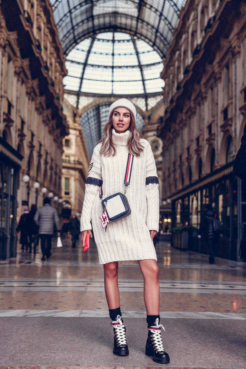 6d67dd627 Street style - Tommy Hilfiger sweater dress, cross body bag, beanie + Gucci  hiker boots for the Tommy Hilfiger x Gigi Hadid fashion show during Milan  ...