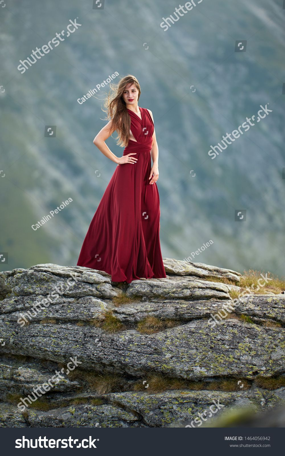 Beautiful female fashion model in red dress on mountain rocks #Sponsored , #sponsored, #fashion#model#Beautiful#female