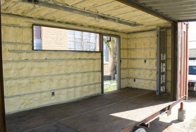 Shipping Container Homes Spray foam interior INSULATION in addition to having the cargo container encased in earth bags on outside walls of the containers. You'll be plenty cool in the summer and cozy and well INSULATED in the winter.
