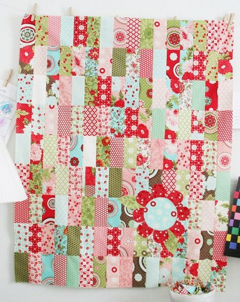 I whipped up this baby quilt a while ago using 2 Bliss charm packs. If you want to make a quilt like this start with 2 Charm packs. There should be 80 squares and you only need 72…