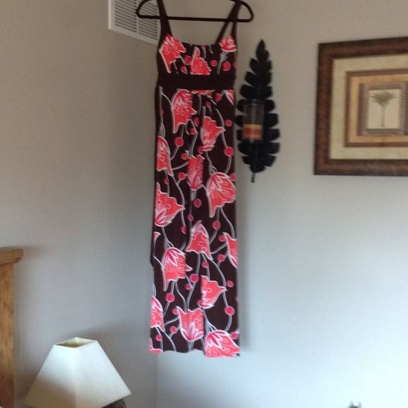 Maxi dress Beautiful maxi dress that has bright orange flowers on a brown background . Padding in chest area for extra lift or no bra needed. Has spaghetti straps and also ties in the back. Perfect for a tropical or cruise vacation. Only worn once. Dresses Maxi