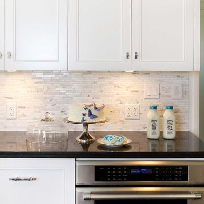 White Cabinets + Black Granite + Carrera Backsplash Design