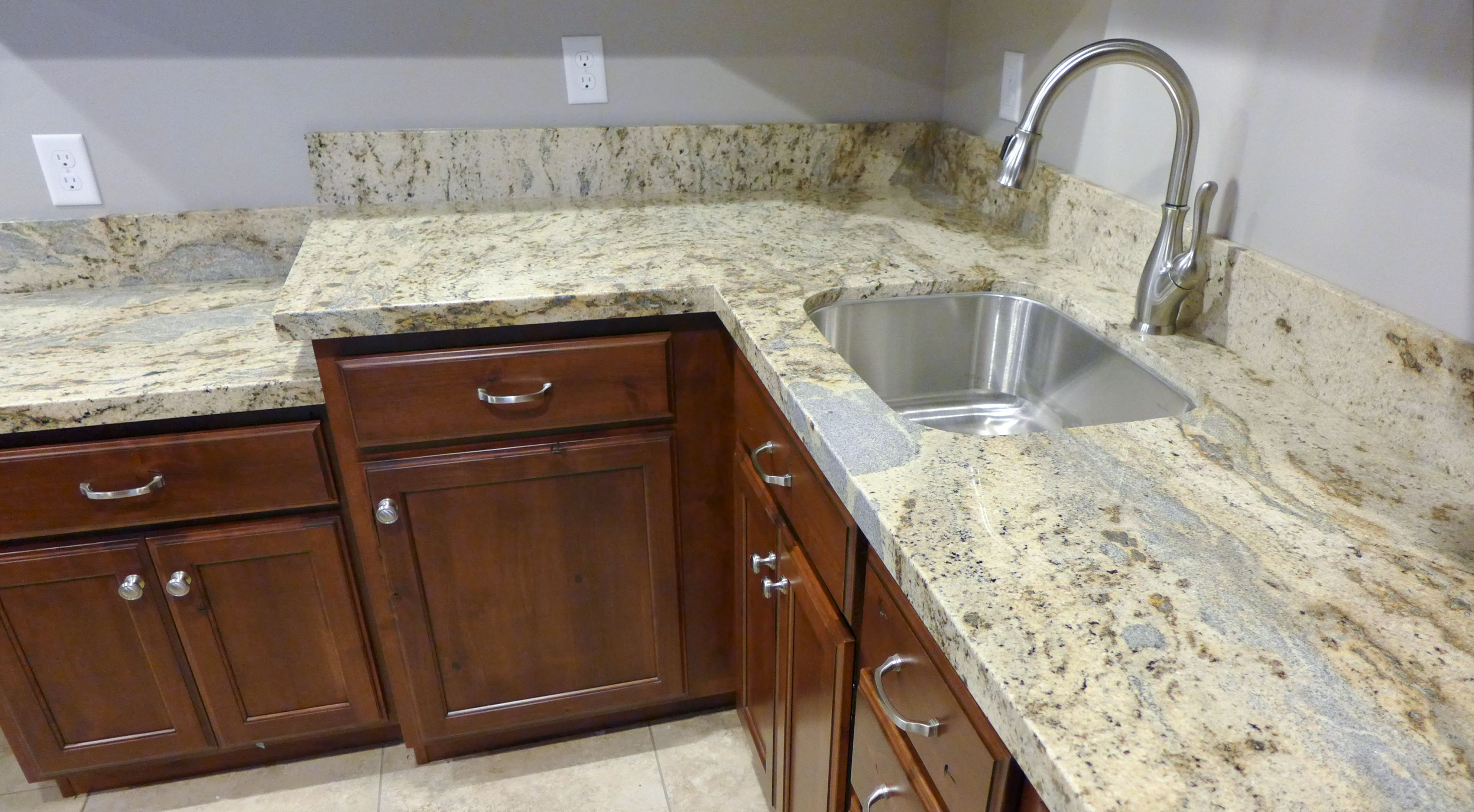 Stunning granite countertop provided by Accent Interiors in