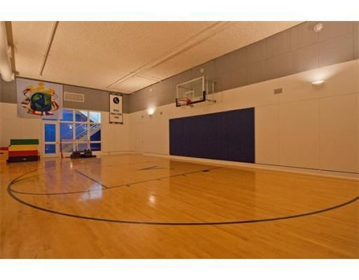 A Professional Grade Indoor Home Basketball Court Weston Ma Coldwell Banker Residentia Home Basketball Court Indoor Basketball Hoop Indoor Basketball Court