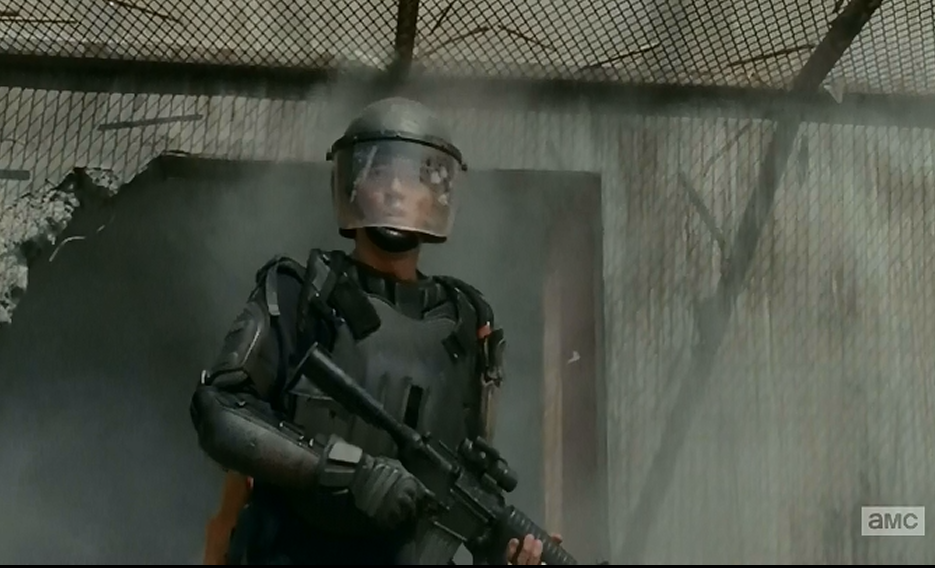 Glen appears covered in the riot gear he had stored to try and get