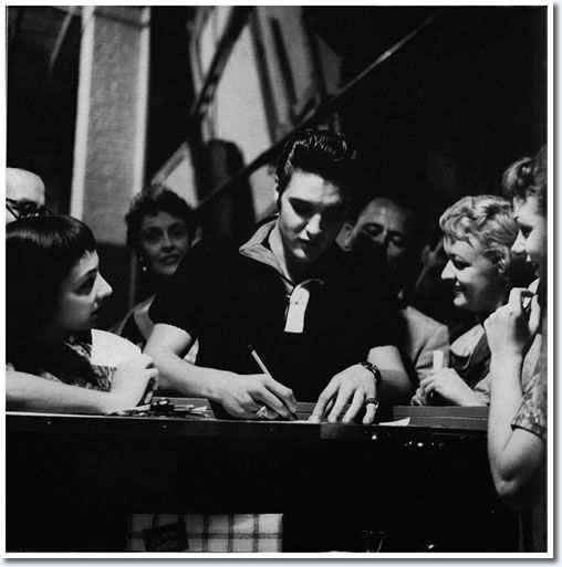 Elvis Signs Some Autographs With British Comedienne Joyce