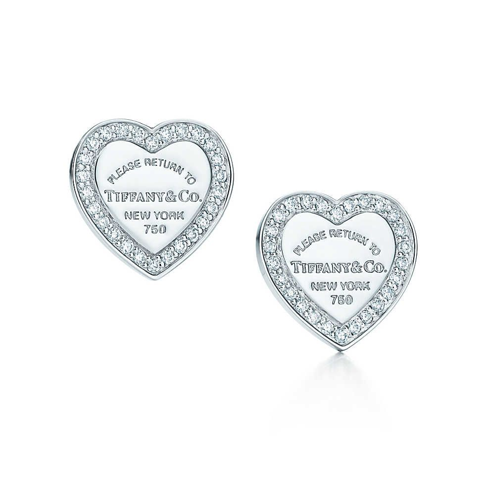 9766d5e83 Return to Tiffany™ mini heart tag earrings in 18k white gold with diamonds.