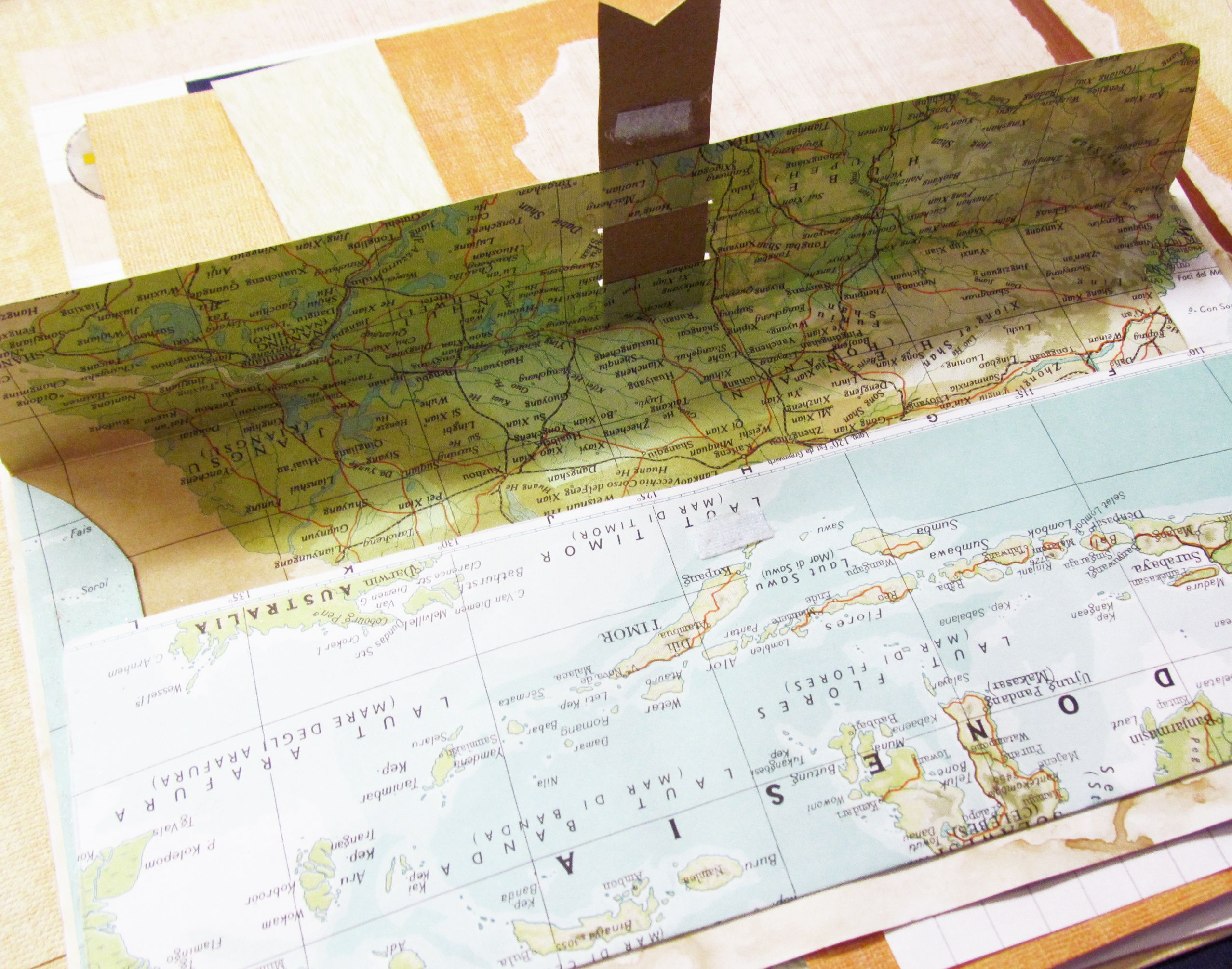 Crafty envelope made with old map to store memories, perfect page of a travel journal.