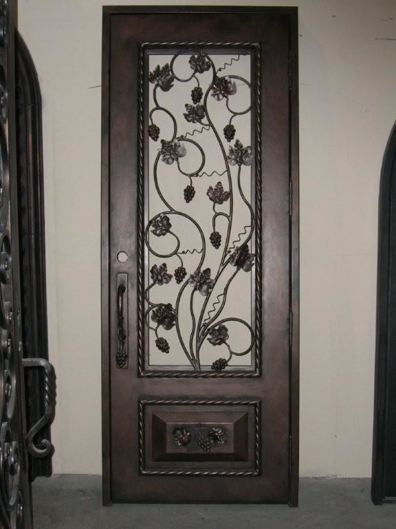 Wine cellar doors wrought iron wine cellar door with for Decorative main door designs