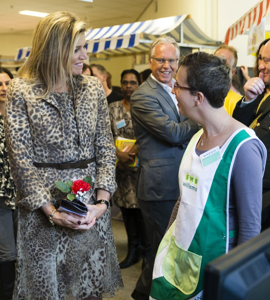 Queen Maxima of The Netherlands talks with Anneke Engelen during a visit to the social employment agency Breed on October 7, 2014 in Nijmegen The Netherlands.