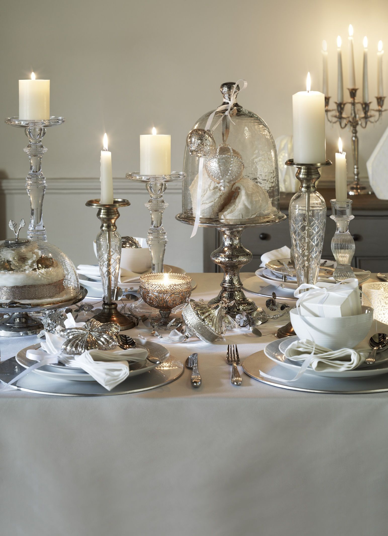 Decorate Your Dining Table With Elegant Candles And Silver Decor Opt For Matching Dining Sets T Christmas Table Settings Christmas Table Christmas Dining Room