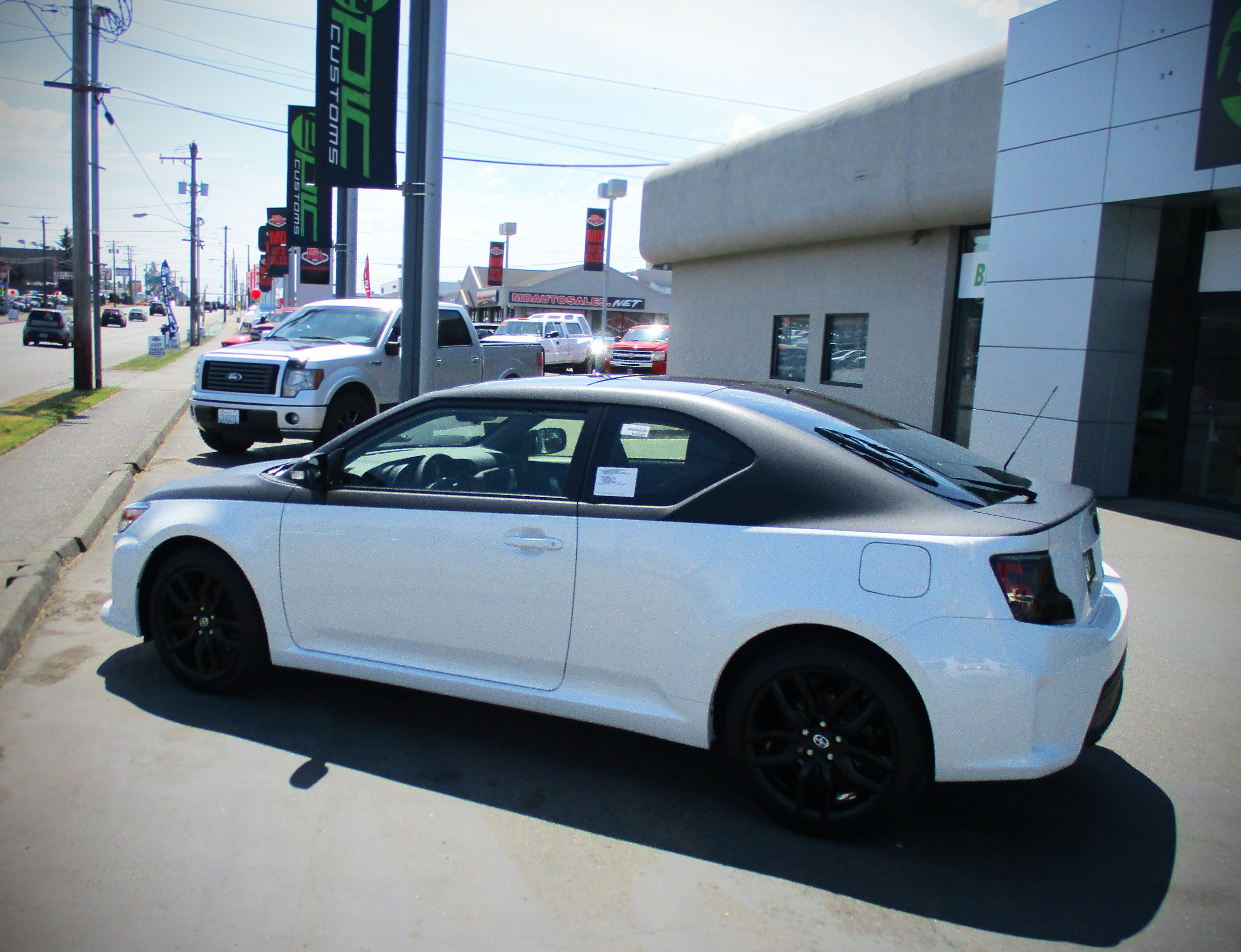 Scion tc with a custom two tone matte black and white wrap done by