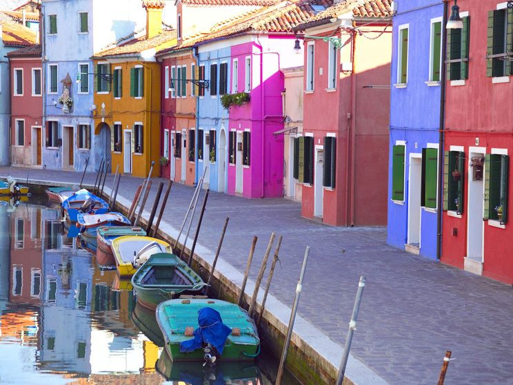 Delightfully coloured homes and boats in the streets of Venice.  #Venice #Italy #Holiday