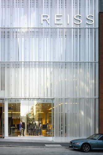 Reiss Headquarters by Squire & Partners, London, UK - Triple skin facade. Facade is made of highly engineered acrylic, milled vertically to mimic fabric draped across the facade. The milled acrylic has a very high light conductivity which was important since the initial concept was for a 'glowing' facade visible from nearby Oxford Street.