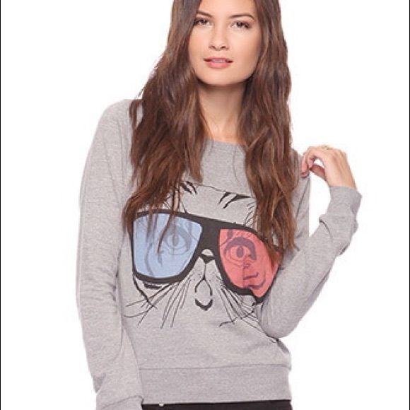 """3D Cat Pullover Knit pullover features cat wearing 3D glasses. Crew neckline. Raglan sleeves. Rib at neckline, cuffs and hem.   DETAILS: -23"""" approx. length from high point shoulder to hem, 35"""" chest, 35"""" waist, 26.5"""" sleeve length from neckline  - Measured from Small  - 60% cotton, 40% polyester  - Machine wash cold, tumble dry low  - Imported Model Info: Height: 5'10"""" 