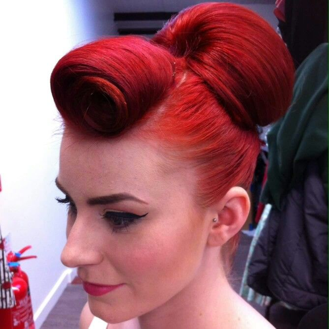 Rockabilly hair...suicide curls and a bright red bun! love this style and color