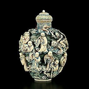 A large carved ivory snuff bottle  Qianlong period, 1736–1795