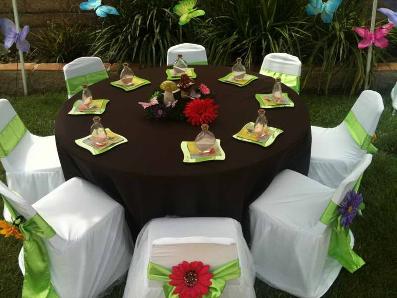 party table setup with green ribbon
